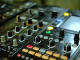 nightclub dj playing mix on soundboard console with flashing lights and buttons blgpd0tu8l thumbnail full01