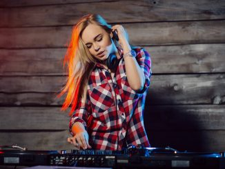 cute dj woman having fun playing music at club par P97P3F8